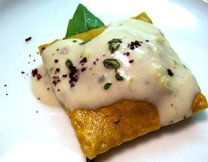 Roasted Pumpkin Ravioli with Thyme and Riesling Cream courtesy of 4 Course Vegan